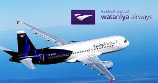 Logomarca da Watania Airways com avião plainando